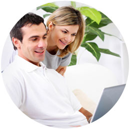 smiling couple with computer screen